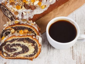 Portion of poppy seeds cake and cup of coffee, dessert for Christmas